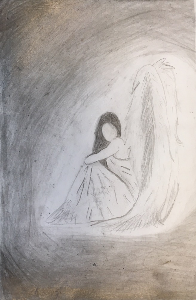 girl sitting with wings